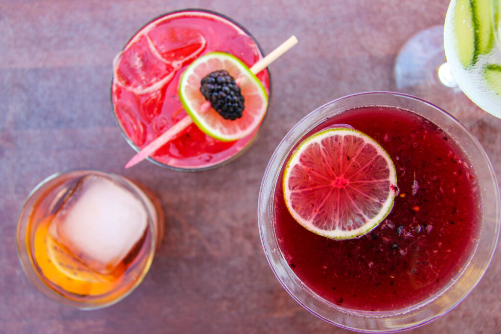 colorful assortment of cocktails with different fruits and glassware