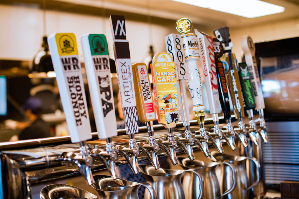 assorted beer tap handles at the bar